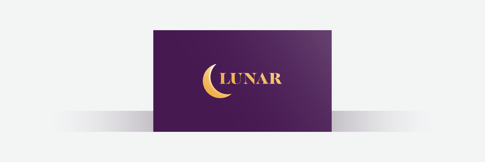 Dark purple business card with gold font and crescent moon