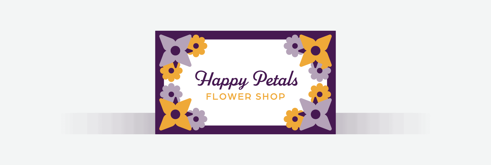 Business card with a dark purple frame and flowers