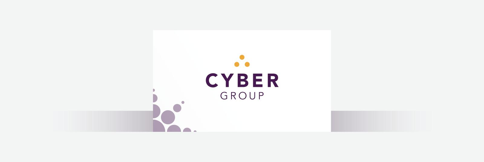 White business card with a dark purple sans serif font