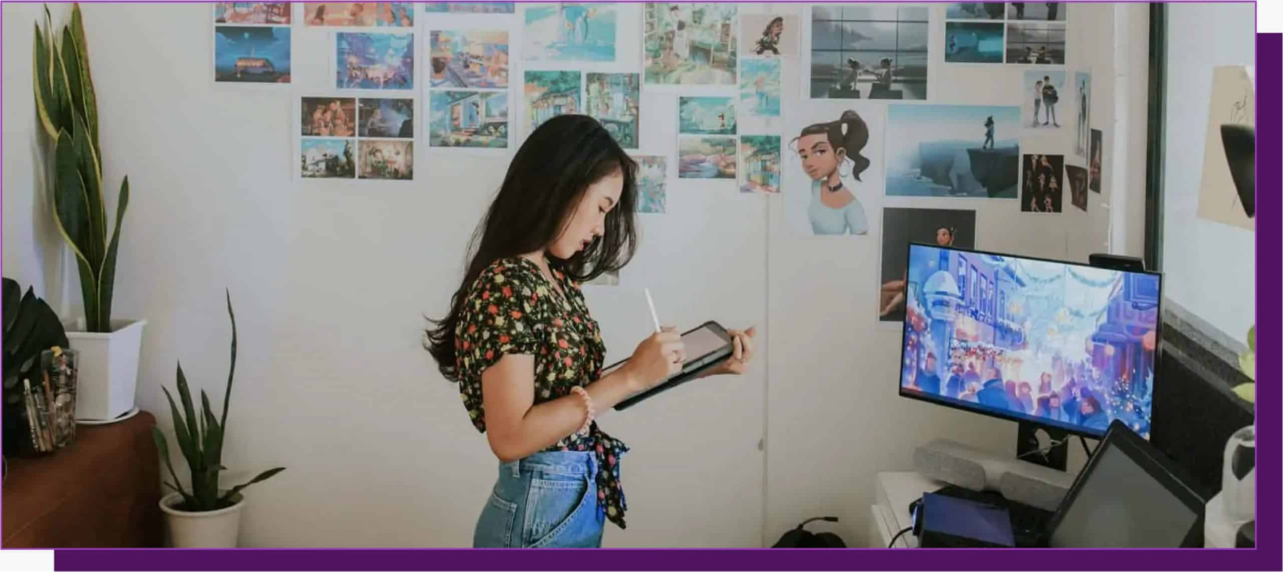 Female using drawing tablet to make digital art to add to her collection