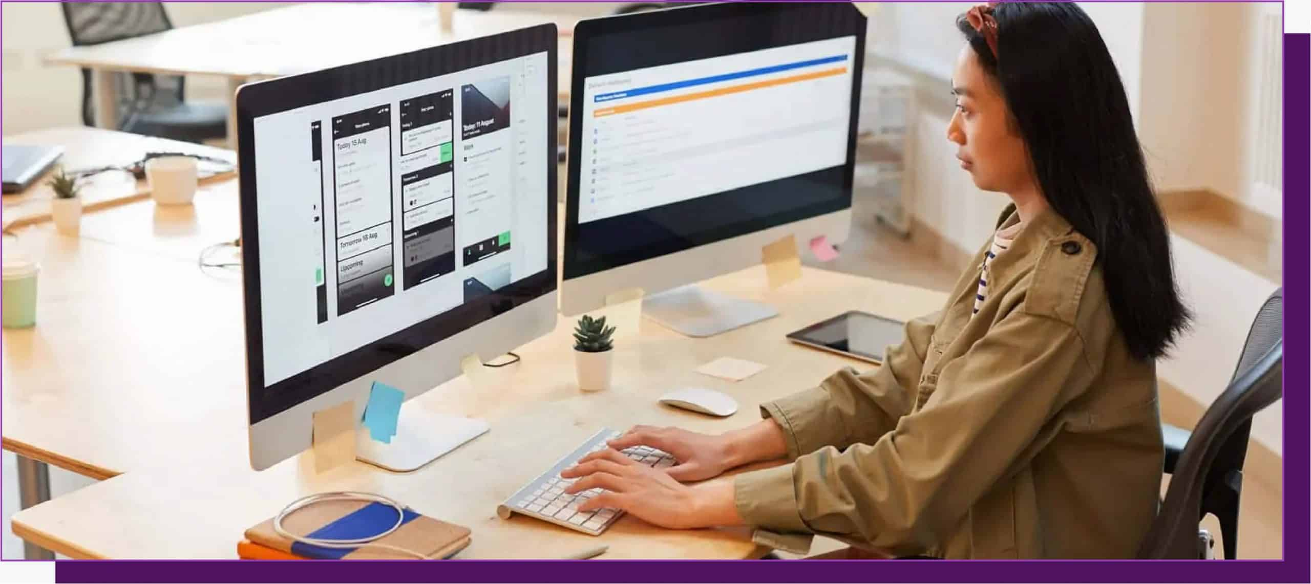 Woman typing on computer screen with designs on it